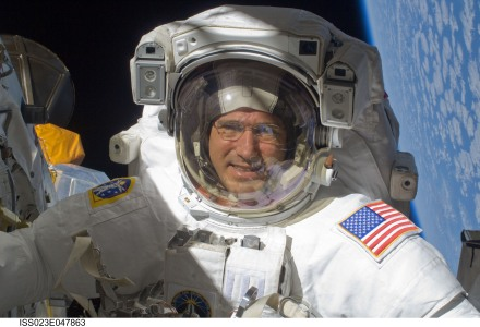 Mike Good on a spacewalk outside the shuttle Atlantis. Photo courtesy of Mike Good.
